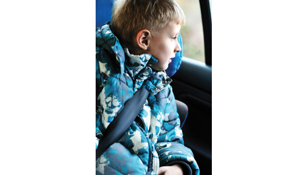 Child in car looking out window