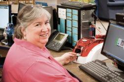 Woman at an ID maker