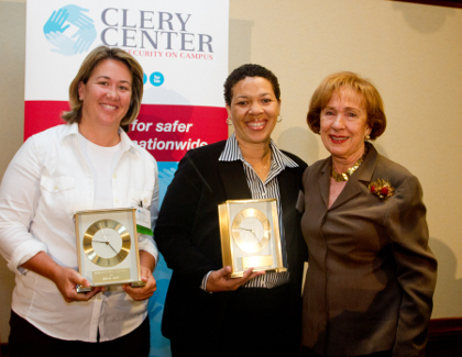 Allison Jacobs (left) and Lisa Campbell (center) accept their awards from Connie Clery