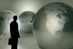 Man with three globes
