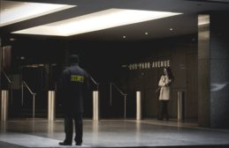 Security guard in building lobby