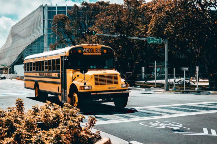 School bus drives down street