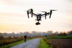 Drone surveillance over sidewalk