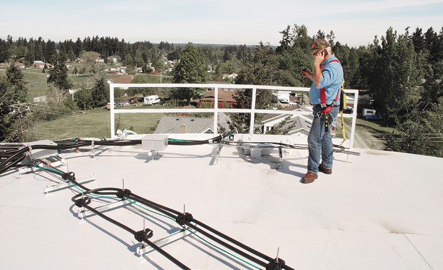 Mt. View-Edgewood Water Company's Mike Craig, field manager, at the top of a water tower where the wireless motion detector is virtually hidden