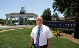 Chief of Security and Transportation Jeff Karpovich stands outside one of the High Point University Welcome Centers