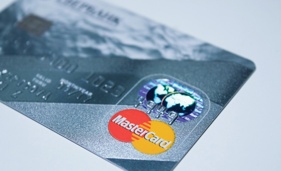 U.S. credit card companies are making the transition from magnetic stripe technology to cards with chips