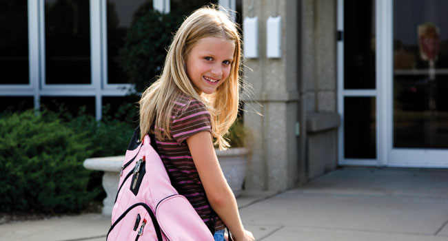 Girl with Pink Backpack slide