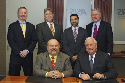 Pictured in photo: Standing (l to r): Pete Ladowicz, DHS; Stephen Hancock, DHS; Oren Gruber, DHS; and Jack Lichtenstein, ASIS. Seated (l to r): Dr. Keith Holtermann, DHS and Michael J. Stack, ASIS.